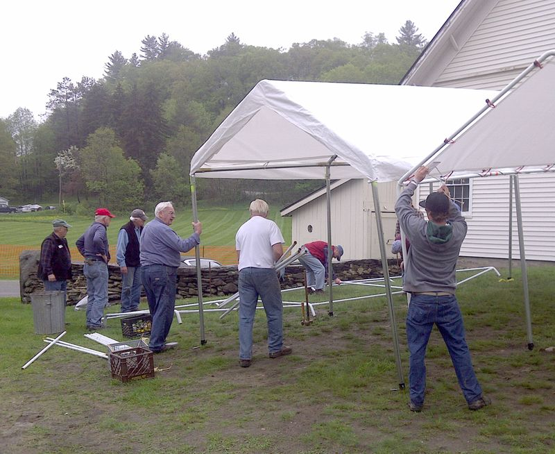 BRGN erecting tents for rummage sale 5 19 2011
